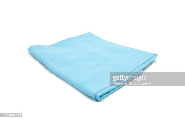 high angle view of blue textile against white background - napkin stock pictures, royalty-free photos & images