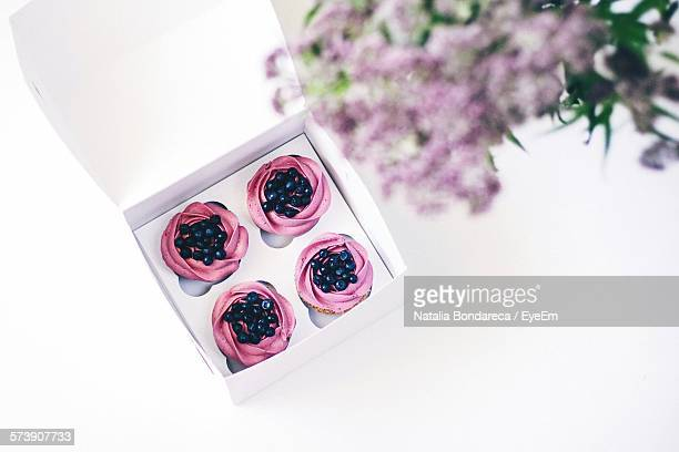 High Angle View Of Blueberries Cupcakes In Box On White Table