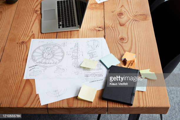 high angle view of blueprint in office board room - business plan stock pictures, royalty-free photos & images