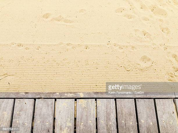 High Angle View Of Boardwalk By Sand At St Kilda Beach