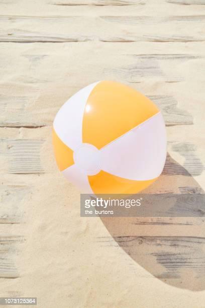 high angle view of boardwalk with sand and beach ball - pelota fotografías e imágenes de stock
