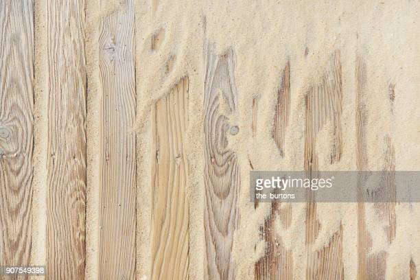 high angle view of boardwalk with sand - sandig stock-fotos und bilder
