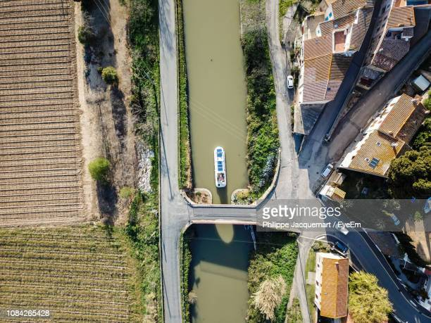 high angle view of boat in paraza river by buildings - canal du midi photos et images de collection