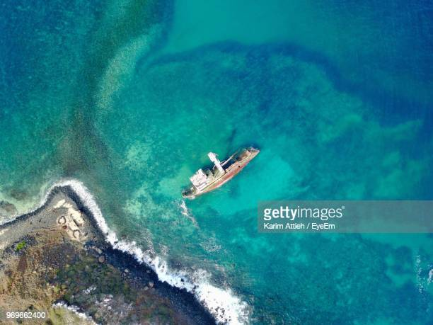 high angle view of boat in sea - dakar photos et images de collection