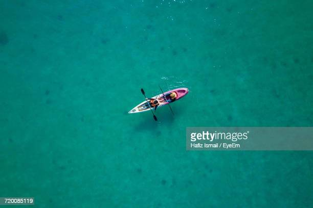high angle view of boat in water - kajak stock-fotos und bilder