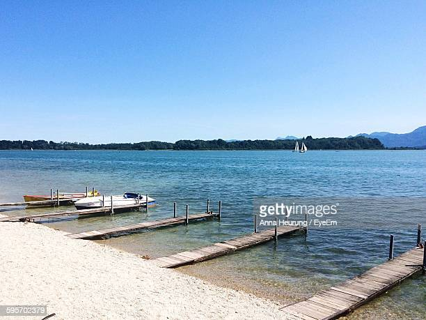High Angle View Of Boat Moored At Jetty By Lake Chiemsee
