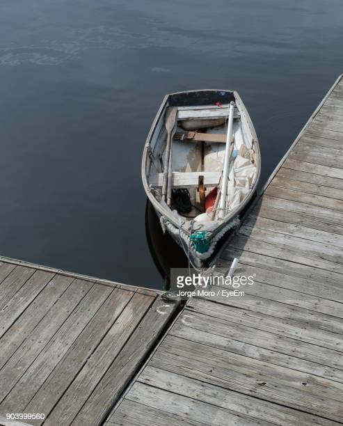 High Angle View Of Boat Moored By Jetty At Lake