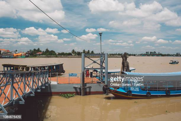high angle view of boat moored by pier over river against sky - bortes stock pictures, royalty-free photos & images