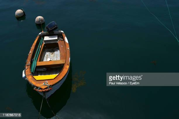 high angle view of boat moored in sea - faro district portugal stock pictures, royalty-free photos & images