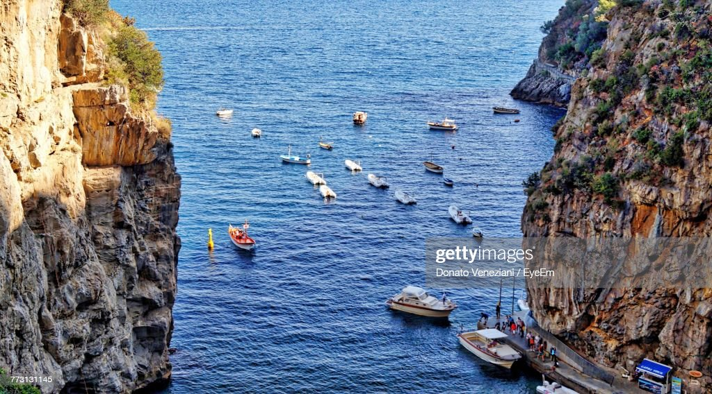 High Angle View Of Boat On Sea By Mountains : Photo