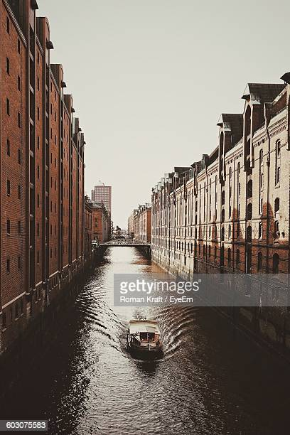 High Angle View Of Boat Sailing On Canal In City