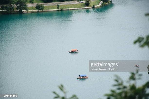 high angle view of boat sailing on lake - jelena ivkovic stock pictures, royalty-free photos & images