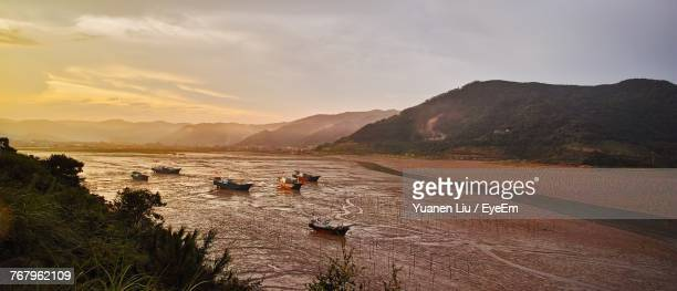 high angle view of boats against mountains - liu he stock pictures, royalty-free photos & images