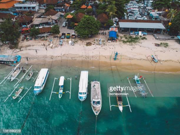 high angle view of boats by the beach - bortes foto e immagini stock