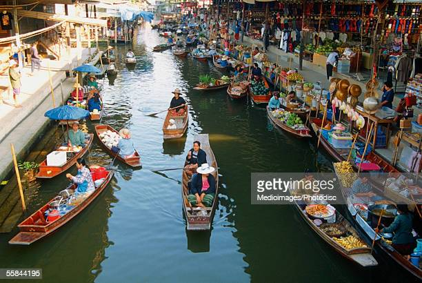high angle view of boats, damnoen saduak floating market, bangkok, thailand - floating market stock pictures, royalty-free photos & images