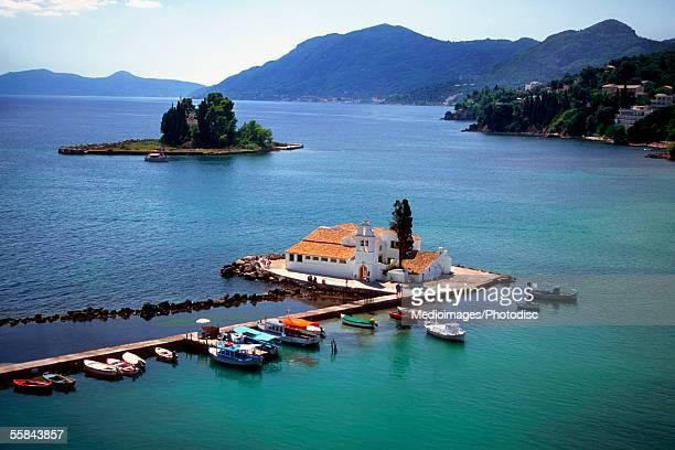 High angle view of boats docked near a monastery, Kanoni, Mouse Island, Corfu, Greece