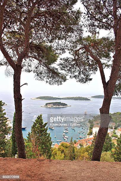 high angle view of boats in calm sea - hvar stock photos and pictures