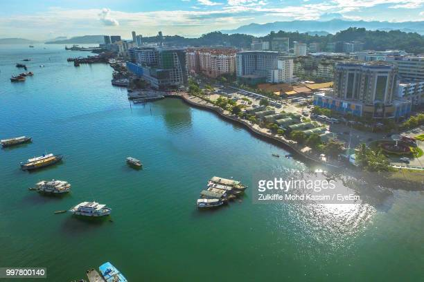 high angle view of boats in city - kota kinabalu stock pictures, royalty-free photos & images