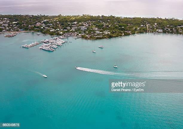 high angle view of boats in river - harbor island bahamas stock photos and pictures