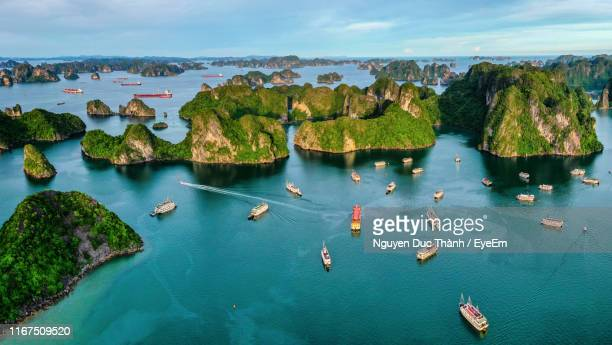 high angle view of boats in sea - halong bay stock pictures, royalty-free photos & images