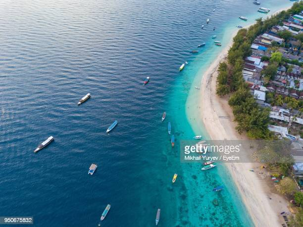 high angle view of boats in sea - gili trawangan stock photos and pictures