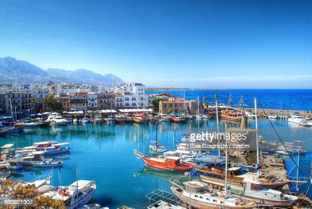 high angle view of boats moored at harbor against clear blue sky - repubiek cyprus stockfoto's en -beelden