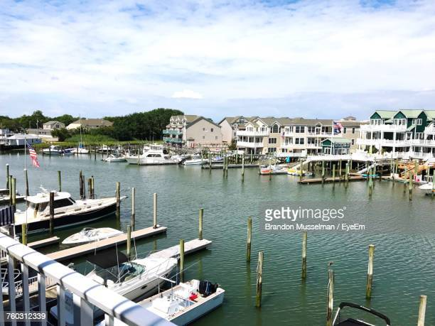 high angle view of boats moored at harbor in city - cape may stock pictures, royalty-free photos & images