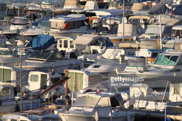 high angle view of boats moored at harbor - boris stock photos and pictures