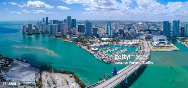high angle view of boats moored at harbor - miami foto e immagini stock