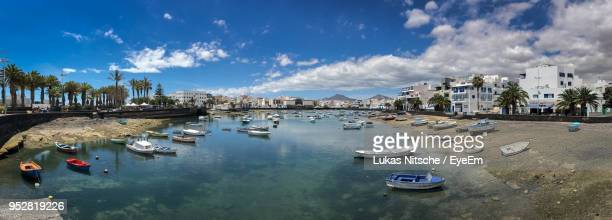 high angle view of boats moored at harbor - arrecife stock photos and pictures