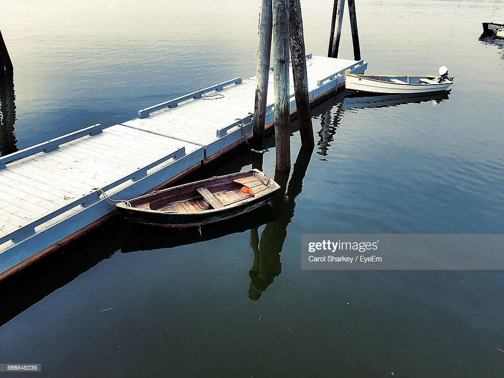 High Angle View Of Boats Moored By Pier : Stock Photo