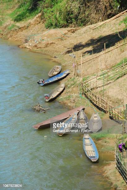 high angle view of boats moored by river - gerhard schimpf stock photos and pictures