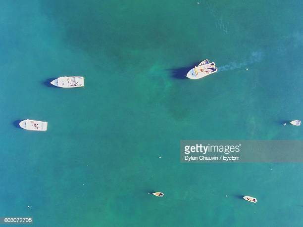 high angle view of boats moored in calm blue sea - chauvin stock pictures, royalty-free photos & images