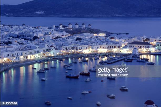 High Angle View Of Boats Moored In Sea At Night