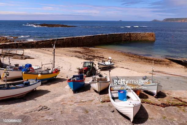 High Angle View Of Boats Moored On Beach Against Sky