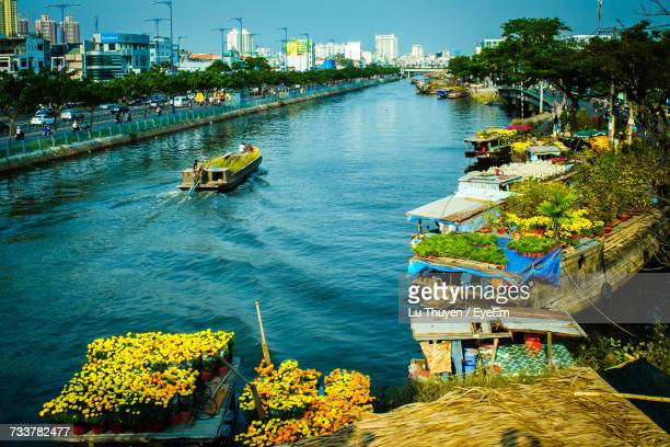 High Angle View Of Boats Moored On River In City