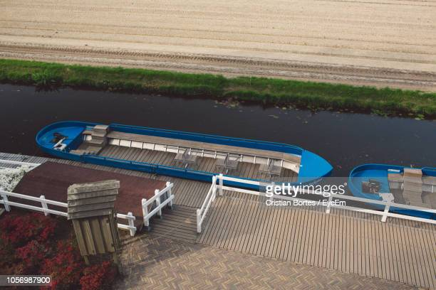 high angle view of boats moored on river - bortes stock pictures, royalty-free photos & images