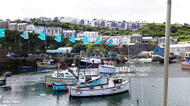 high angle view of boats moored on river - mevagissey stock photos and pictures