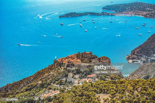 high angle view of boats on beach - saint jean cap ferrat stock pictures, royalty-free photos & images