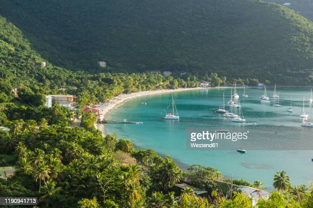 high angle view of boats on cane garden bay, british virgin islands - cane garden bay stock pictures, royalty-free photos & images