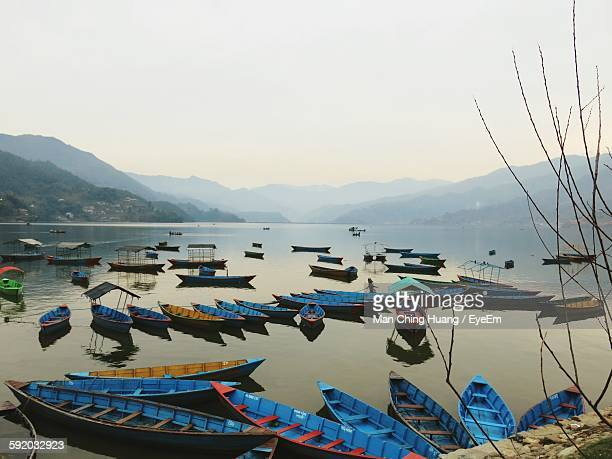 High Angle View Of Boats On Lake Against Sky