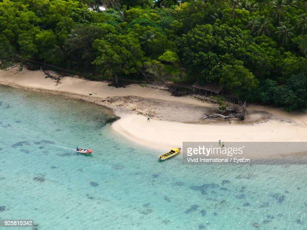 High Angle View Of Boats On Sea At Beach