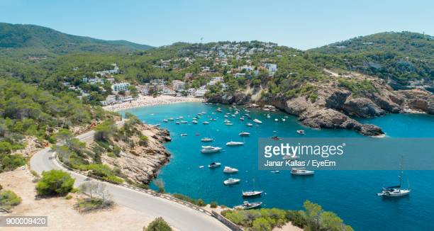 high angle view of boats sailing in sea against clear sky - insel ibiza stock-fotos und bilder