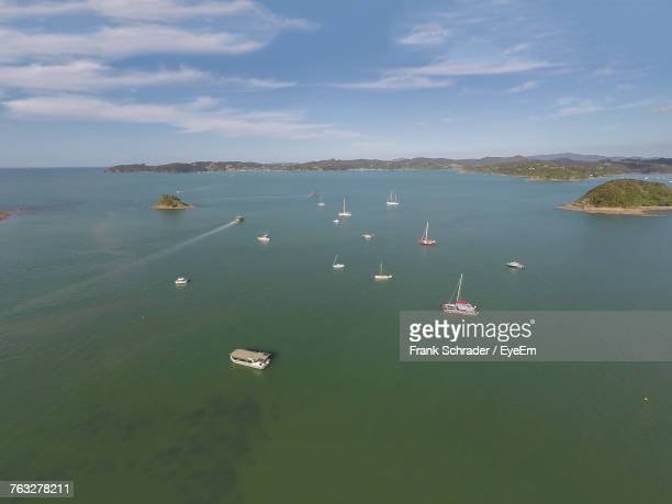 High Angle View Of Boats Sailing In Sea Against Sky