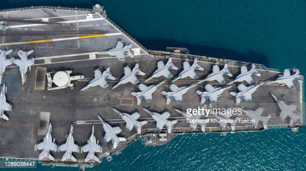 high angle view of boats sailing in sea - military stock pictures, royalty-free photos & images
