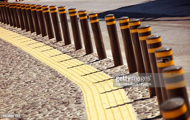 high angle view of bollards on sidewalk - bollard stock photos and pictures