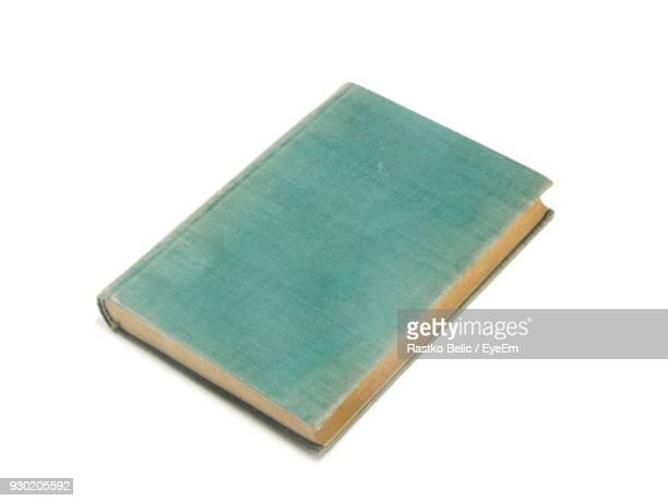 High Angle View Of Book Against White Background