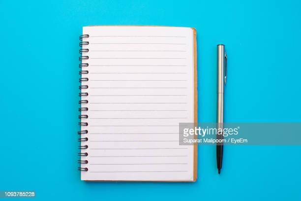 high angle view of book and pink background - note pad stock pictures, royalty-free photos & images
