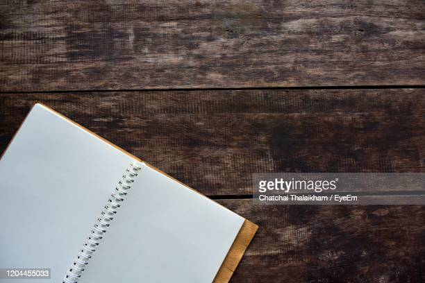 high angle view of book on table - chatchai thalaikham stock pictures, royalty-free photos & images