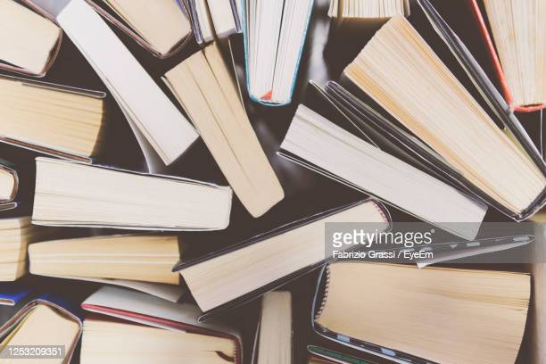 high angle view of books on table - book stock pictures, royalty-free photos & images